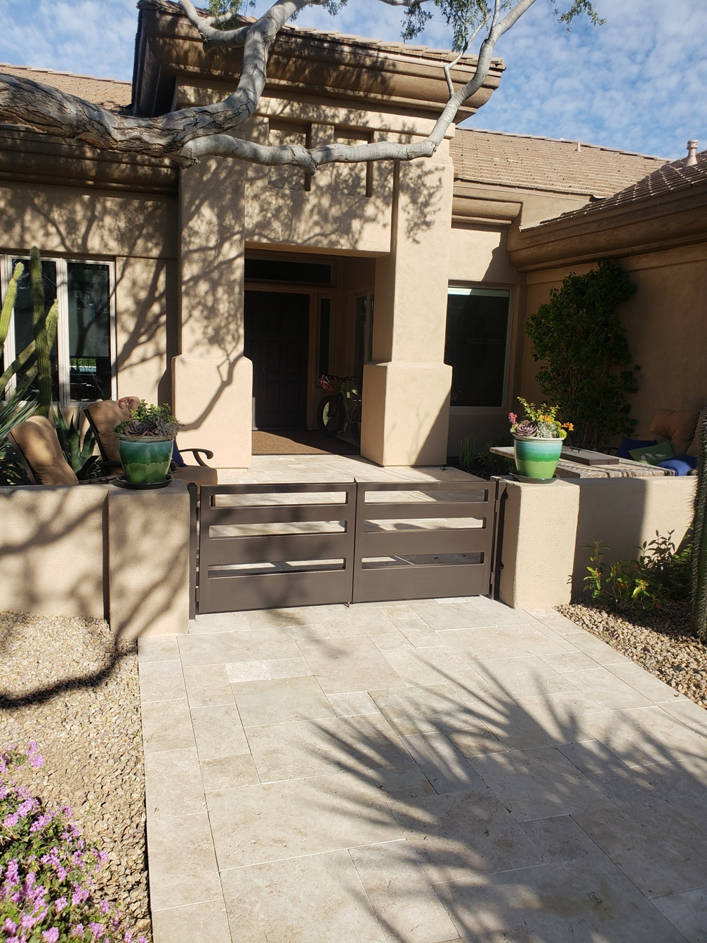 Courtyard looking out of date? Take heart, Scottsdale, travertine pavers are like a magic wand. Presto, chango!