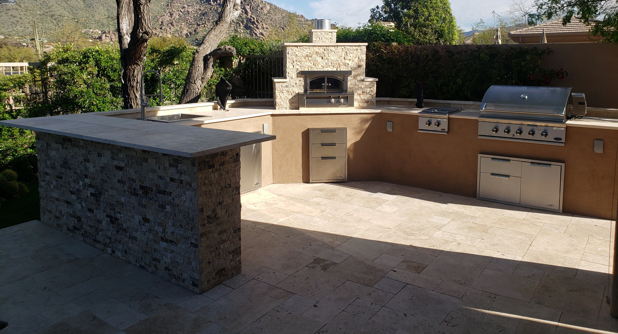 Recently designed and installed outdoor kitchen. Scottsdale clients added all the in-demand items, including an outdoor pizza oven.