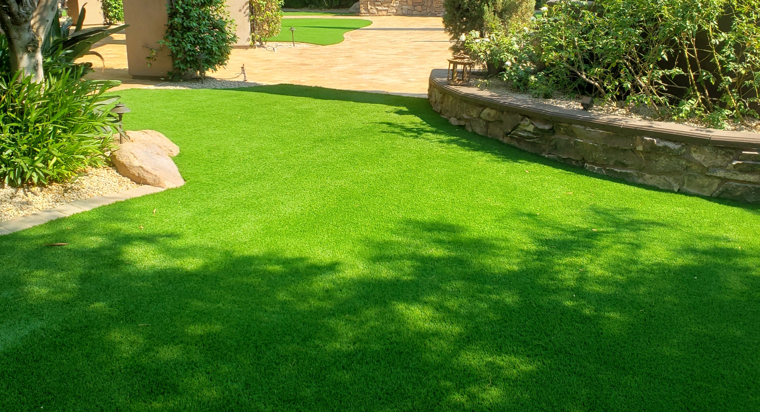 Enjoy that lush look all year with low-maintenance artificia turf. Scottsdale clients picked great quality for long-lasting beauty.