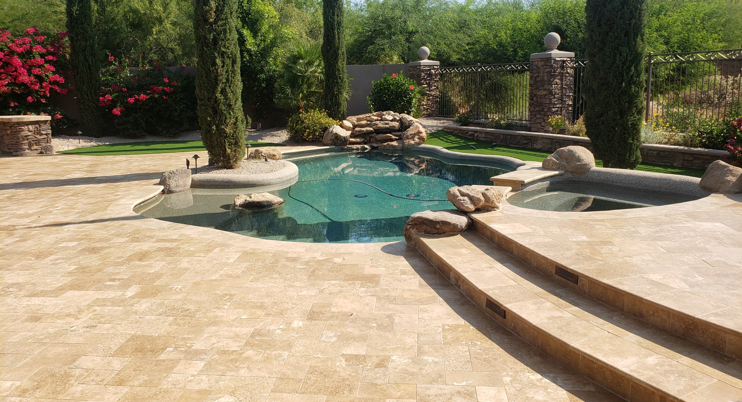 Interested in replacing old kool decking with travertine? Pool deck remodel clients in Scottsdale took their patio and pool deck from drab to fab.